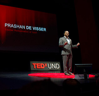 Prashan de Visser (M.A. peace studies, 2015) presents on Global Unites at TEDxUND