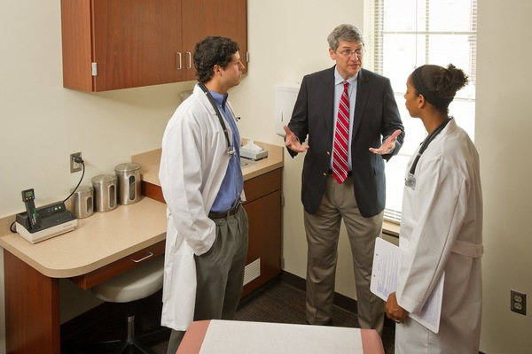 Dr. Dominic Vachon works with undergraduate pre-med majors on doctor-patient interaction