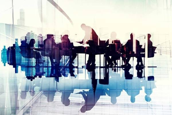 silhouettes of people meeting in a conference room